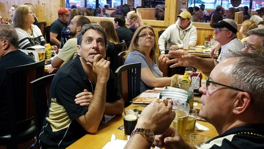 UCF fans gathered at Beef 'O'Brady's in Melbourne to watch the Knights' season opener -- and spend cash on food and drinks.
