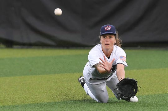 Samantha Cobb of the USA makes a diving catch during Thursday's game against the Dominican Republic.