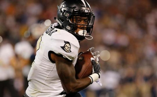 Aug 30, 2018; East Hartford, CT, USA; UCF Knights running back Otis Anderson (2) makes the catch for a touchdown against the Connecticut Huskies in the second quarter at Pratt & Whitney Stadium at Rentschler Field. Mandatory Credit: David Butler II-USA TODAY Sports