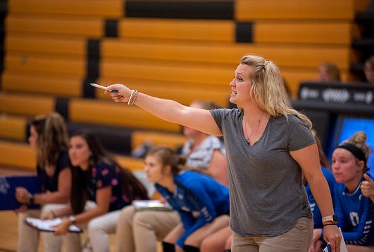 Jamee Burke coached volleyball and softball before focusing on just softball this season.