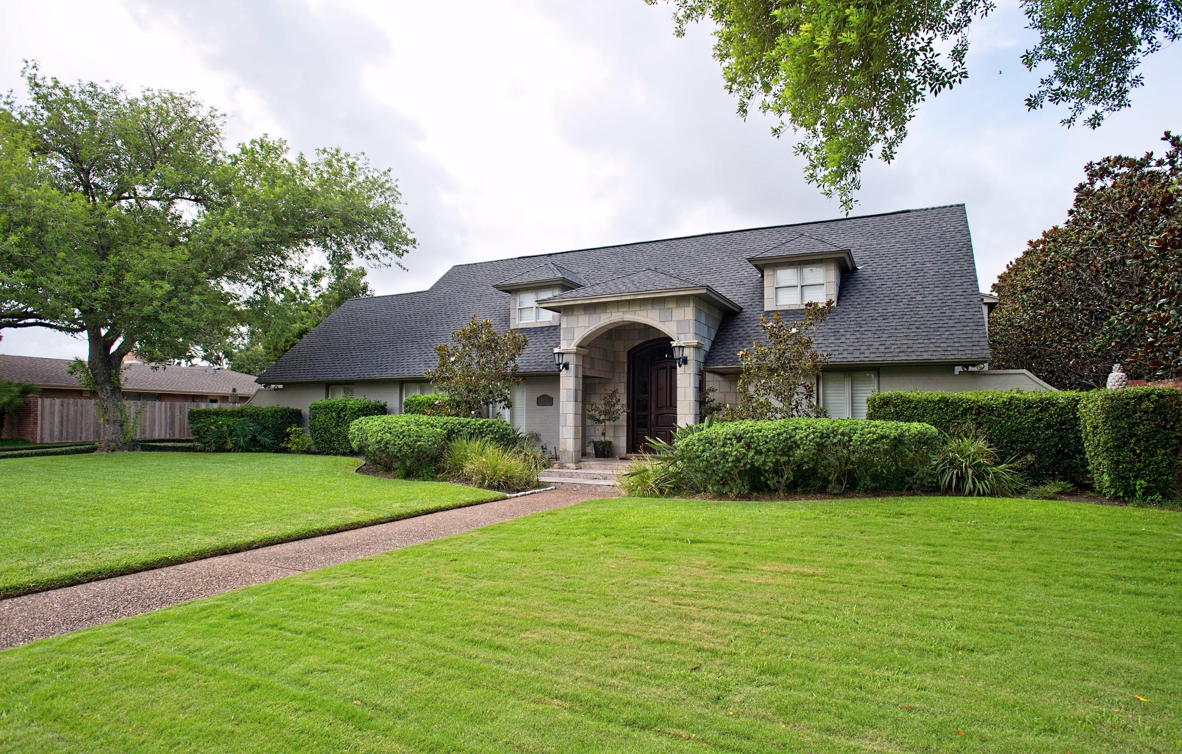 5242 Greenbriar Drive is situated on an oversized lot on the 7th fairway of the Corpus Christi Country Club golf course