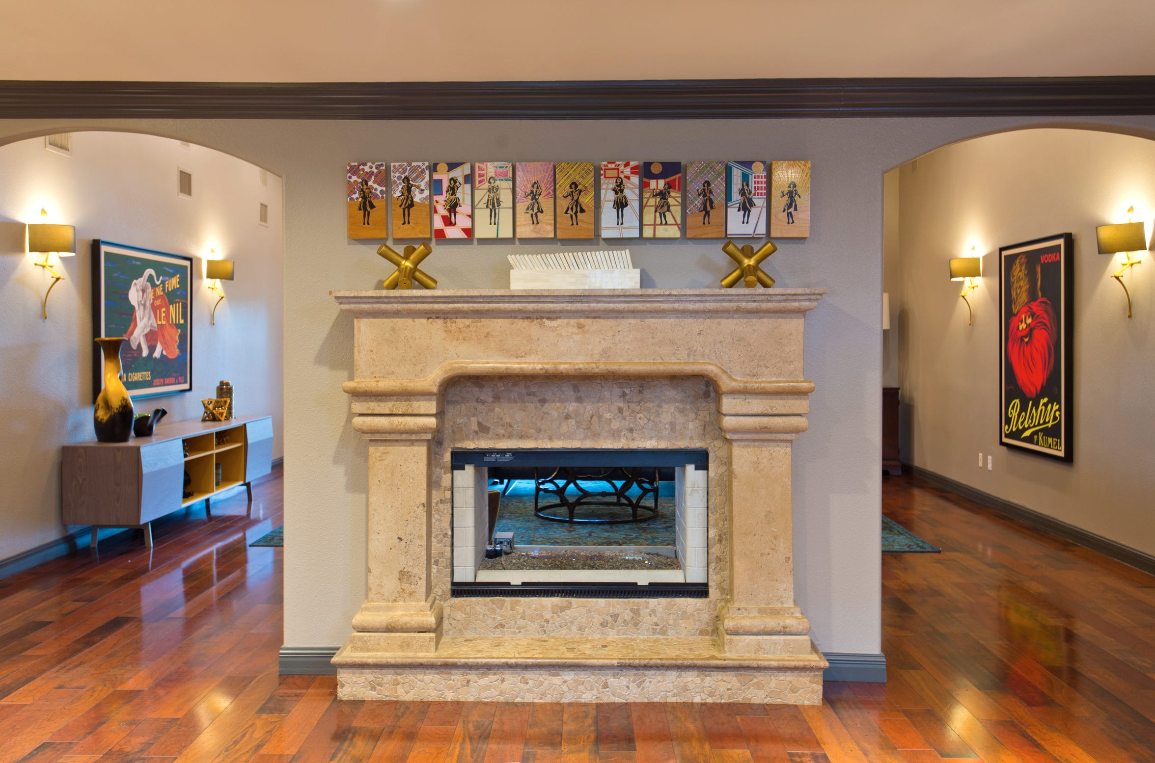 An extraordinary two way fireplace connects the kitchen, living room and bar.