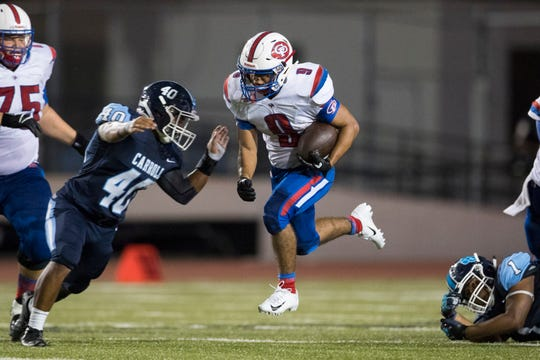 Gregory-Portland's Joe Sauceda rushes the ball against Carroll during their game at Buccaneer Stadium on Thursday, Aug. 30, 2018.