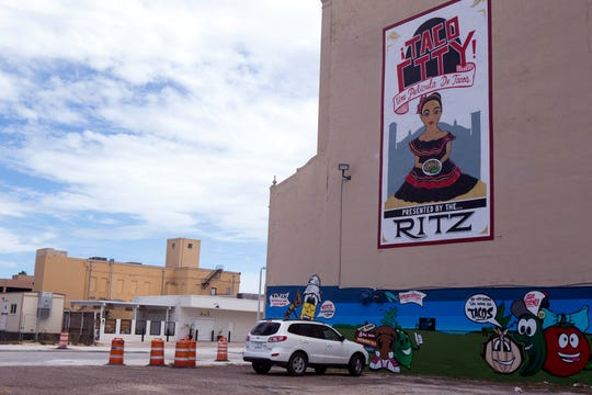 A taco-themed mural adorns the exterior of the Ritz Theater on Chaparral Street on August 31, 2018.