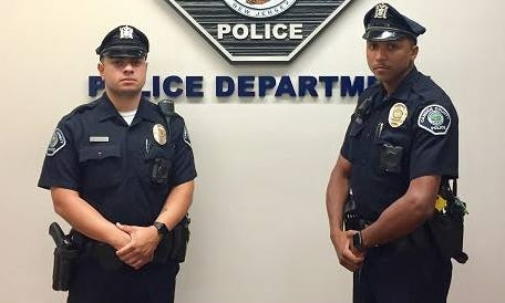 Camden County police officers Damian Caraballo, left, and Vidal Rivera came to the aid of a 5-year-old autistic boy found wandering in Camden.