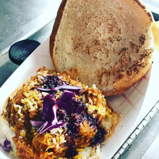 A pulled pork slider comes from the Slider King version of the food truck.
