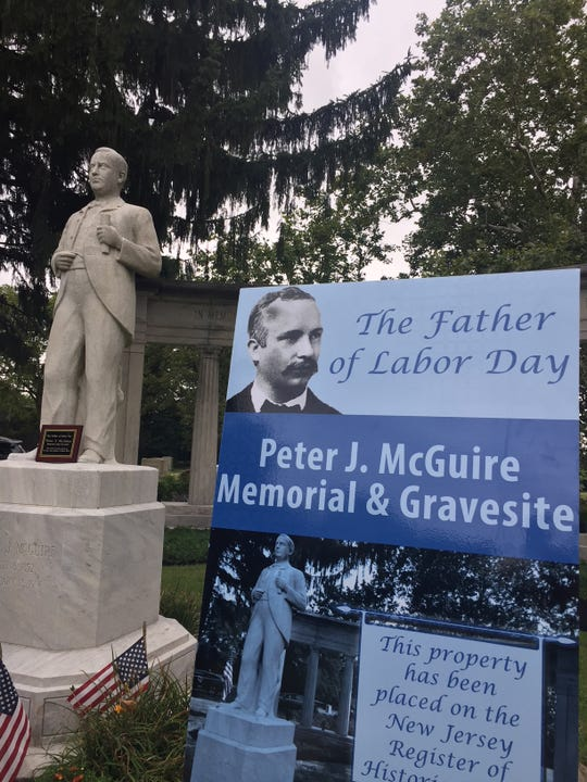 A sign tells of the new designation of this graveside memorial to Labor Day founder Peter J. McGuire in Arlington Cemetery, Pennsauken,  as an official state historic site.