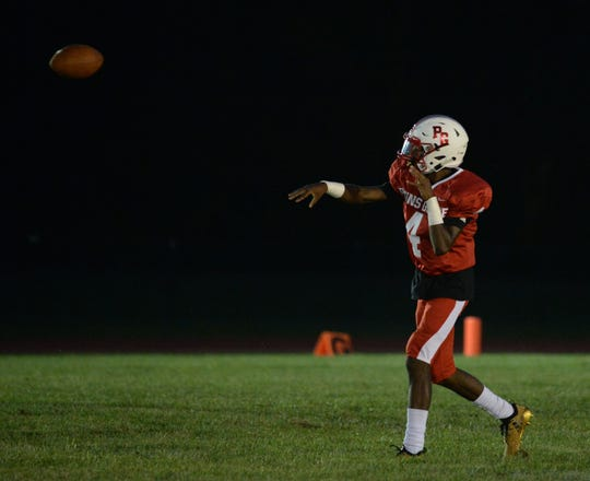 Penns Grove quarterback Kavon Lewis throws a pass last season. Lewis broke the school's career passing touchdown record as the fourth-ranked Red Devils beat Schalick on Saturday.