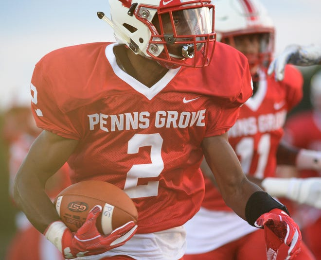 Penns Grove's Jamar Johnson carries the ball for a  touchdown during Thursday night's football game against Pennsville at Penns Grove High School, Aug. 30, 2018.