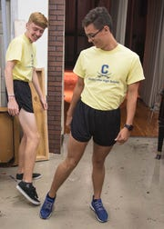 "Senior Ricky Villarreal, right, sports the short shorts look as he and other upperclassmen get ready backstage for the ""What Not to Wear"" fashion show that was presented to incoming freshman during orientation. Plenty of changes are coming to the district as students return to classes this year, including an evolving STEM program from preschool through high school, a new K-2 primary building and a reversal of start times between elementary and middle/high school students."
