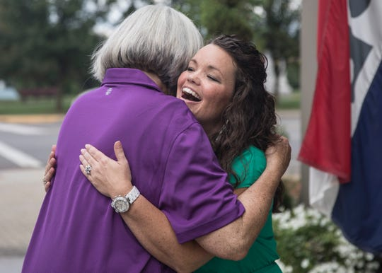 Melissa Huggins, a Chillicothe native, hugs a friends outside of Ivy's Home and Garden Thursday afternoon.
