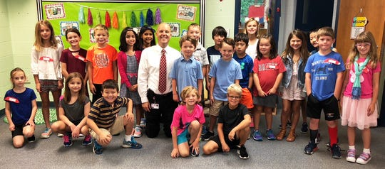 Indian Hill Schools students pose for a photo with their superintendent, Dr. Mark Miles, in the classroom