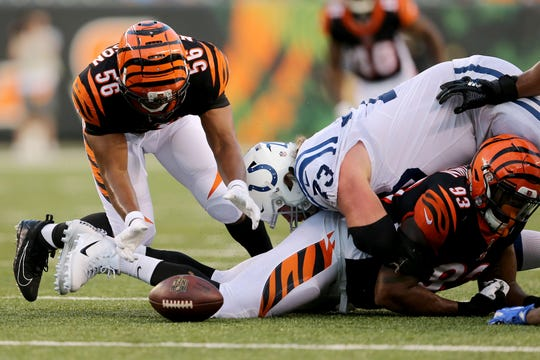 Cincinnati Bengals linebacker Hardy Nickerson (56) recovers a fumble in the second quarter during the Week 4 NFL preseason game between the Indianapolis Colts and the Cincinnati Bengals, Thursday, Aug. 30, 2018, at Paul Brown Stadium in Cincinnati.