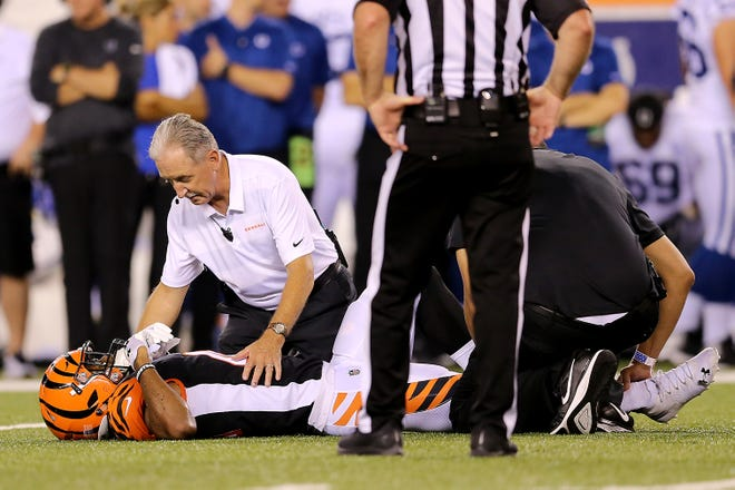 Cincinnati Bengals defensive back Trayvon Henderson (41) is tended to after suffering an injury in the fourth quarter during the Week 4 NFL preseason game between the Indianapolis Colts and the Cincinnati Bengals, Thursday, Aug. 30, 2018, at Paul Brown Stadium in Cincinnati.
