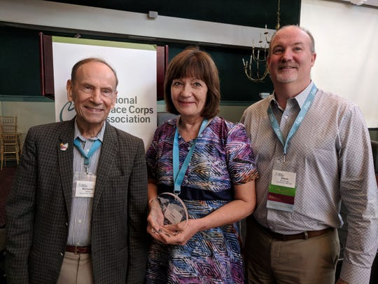 Nick Hoesl (left), Arlene Golembiewski stand with National Peace Corps Association CEO Glenn Blumhorst.