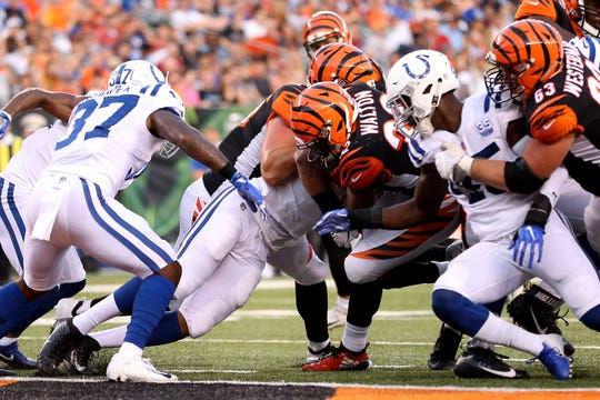 Cincinnati Bengals running back Mark Walton (32) scores a touchdown in the second quarter during the Week 4 NFL preseason game between the Indianapolis Colts and the Cincinnati Bengals, Thursday, Aug. 30, 2018, at Paul Brown Stadium in Cincinnati.
