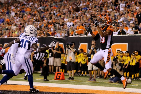 Cincinnati Bengals wide receiver Josh Malone (80) catches a touchdown pass in the second quarter during the Week 4 NFL preseason game between the Indianapolis Colts and the Cincinnati Bengals, Thursday, Aug. 30, 2018, at Paul Brown Stadium in Cincinnati.