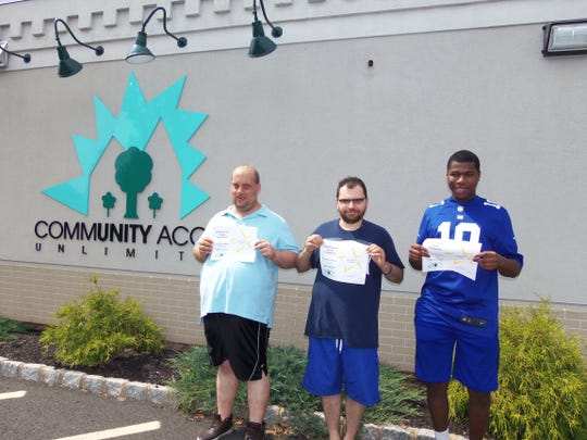 Community Access Unlimited members (left to right) Alphonse Cervone, Joshua Alves and Marcus Barnes proudly display their certificate of completion of employment training at the agency made possible by a grant from the Kessler Foundation.