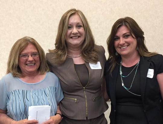 RVCC graduate Laurie Winans, center, is the recipient of the Baker & Rannells Paralegal Studies Student Graduate Award. She is joined by Maria M. DeFilippis, Esq., Coordinator of RVCC's Paralegal Studies program (left), and Kelly Hnasko of Baker & Rannells, Pennsylvania (right).