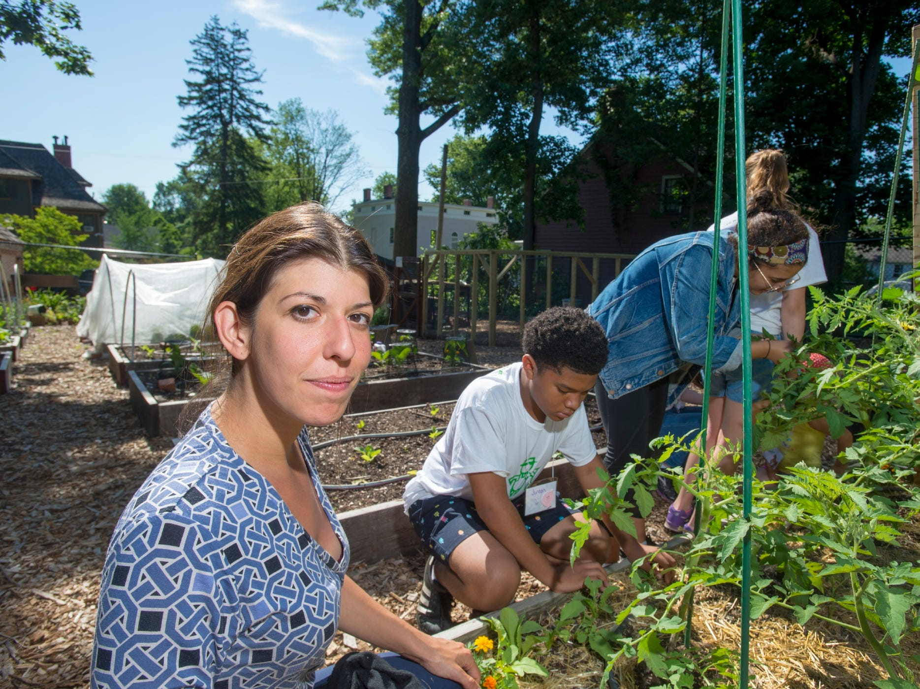 Rutgers extension services help run a 4-H summer camp at the Montclair Community Farm. Pictured in front is Marissa Staffen, a Rutgers graduate and 4-H Essex County Agent.