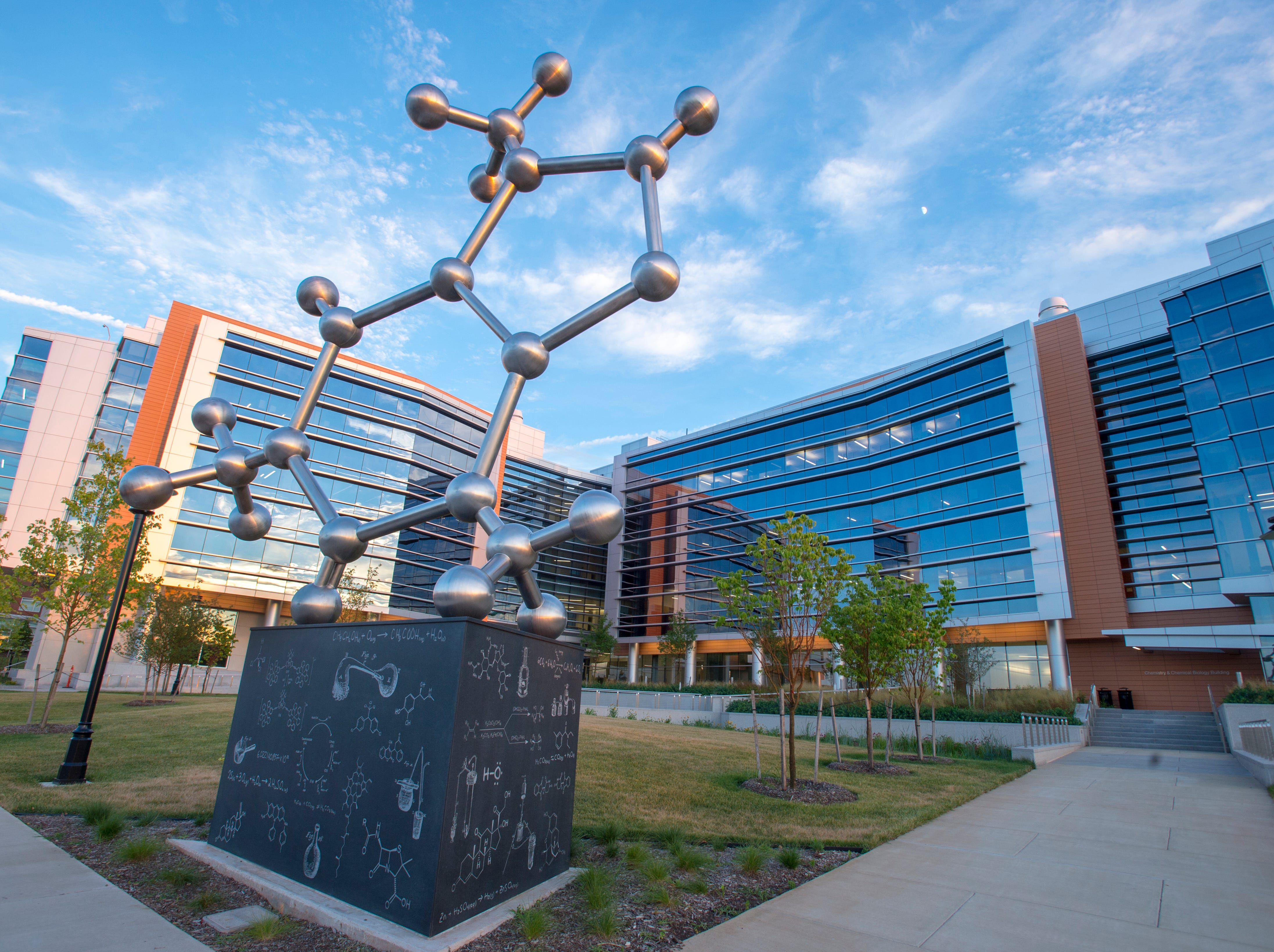 """The PhD Molecule"" sculpture of a caffeine molecule by artist Larry Kirkland stands outside Rutgers University's new Chemistry and Chemical Biology building in New Brunswick."