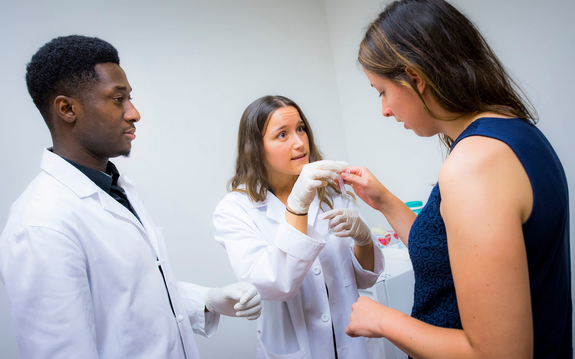 Rutgers School of Arts and Sciences students Adam Khanu, left, majoring in biological sciences, and Marissa McClement, majoring in psychology, demonstrate one of the smoking cessation tests they perform for the Department of Psychology.
