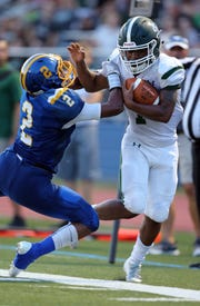 St. Joseph's Jordan Davis gets tackled by North Brunswick's Myles Bailey during the first half on Thursday, Aug. 30, 2018.
