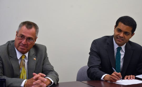 State Health Commissioner Dr. Shereef Elnahal (right) visited with Freeholder Director Ronald G. Rios (left) and County health officials on Aug. 7.