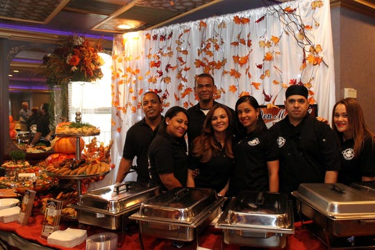 Staff members of the Don Manuel Latin restaurant in Perth Amboy is pictured last year at the annual Taste of Perth Amboy, which will take place on Oct. 18.