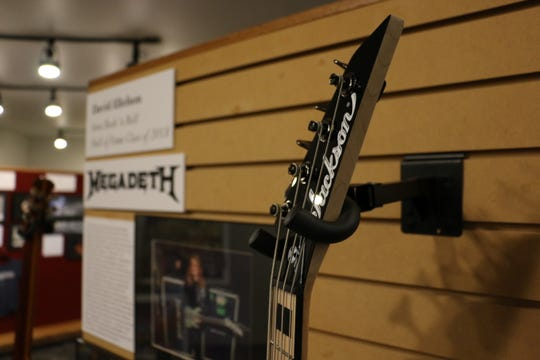 A display for David Ellefson, bassist for Megadeth, inside the Iowa Rock 'n' Roll Music Association Hall of Fame. The hall, located in Arnolds Park, opened in 1997 and inducts about 30 artists, groups or organizations annually.