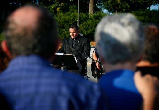 The Rev. Lincon Guerra leads a vigil of Latino community members expressing condolences to Mollie Tibbetts' family and friends on the steps of the Iowa Capital building Aug. 30, 2018.
