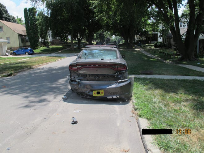 A driver who was texting accidentally hit an Iowa State Patrol car, said Sgt. Nathan Ludwig of Iowa State Patrol.