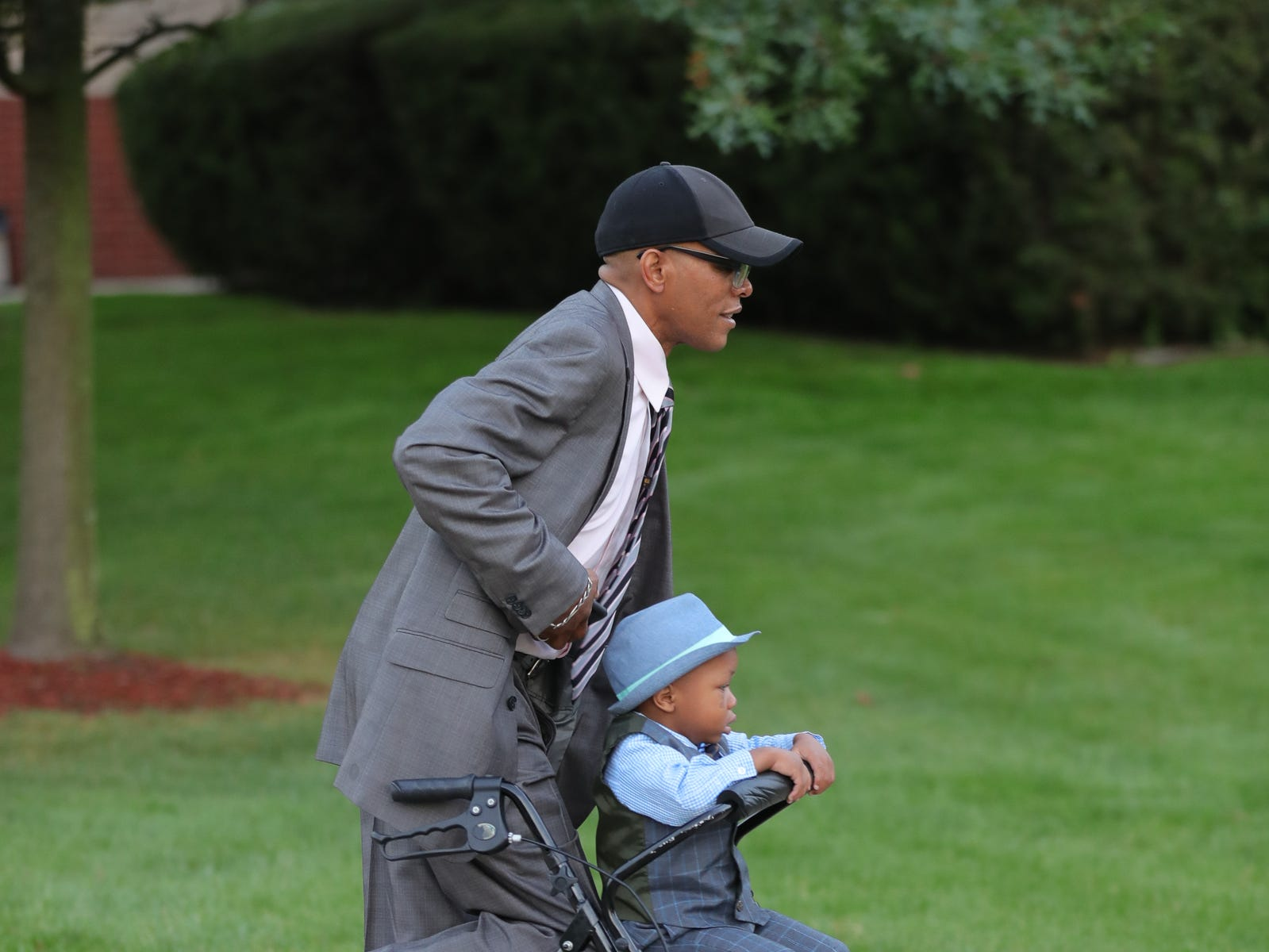 John Cromer  of Detroit pushes his son Jonathan Cromer, 3, as they arrive at Greater Grace Temple in Detroit to say their final goodbye to Aretha Franklin, Friday, August 31, 2018.