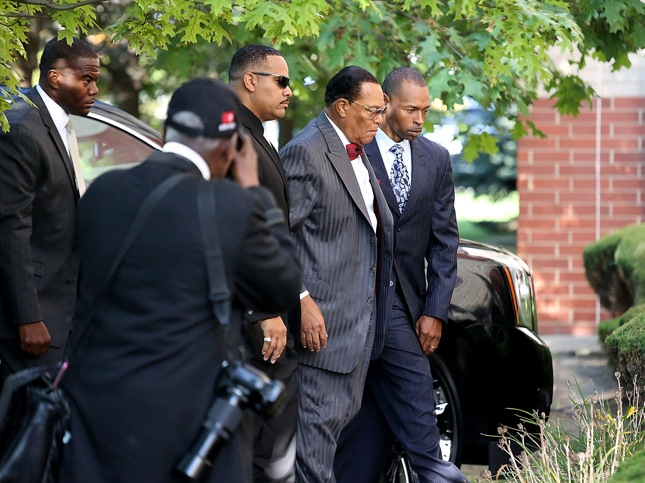 Minister Louis Farrakhan arrives at Greater Grace Temple to pay their final respects to Aretha Franklin in Detroit, on Friday, Aug. 31, 2018.