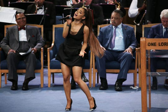 Ariana Grande performs a musical tribute during the funeral for the late Aretha Franklin at Greater Grace Temple in Detroit on Friday, August 31, 2018.