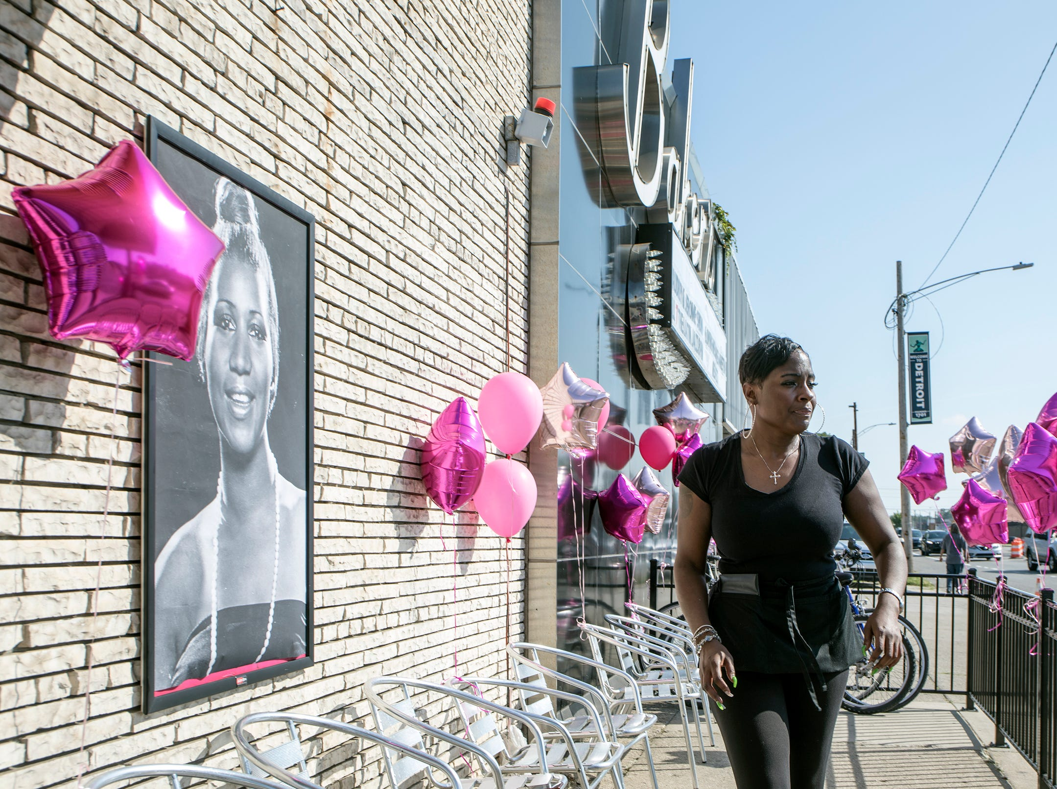 Love Williams, 43, of Detroit finalizes decorations at Baker's Keyboard Lounge in anticipation of Aretha Franklin's funeral to pass by on Livernois Ave. in Detroit, Mich., Friday, August 31, 2018.