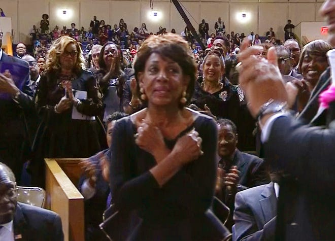 "This image taken from video shows Rep. Maxine Waters, D-Calif., crossing her arms in front of her chest in the ""Wakanda Forever"" greeting from the film ""Black Panther"" as she is acknowledged at Aretha Franklin's funeral at Greater Grace Temple, Friday, Aug. 31, 2018 in Detroit."