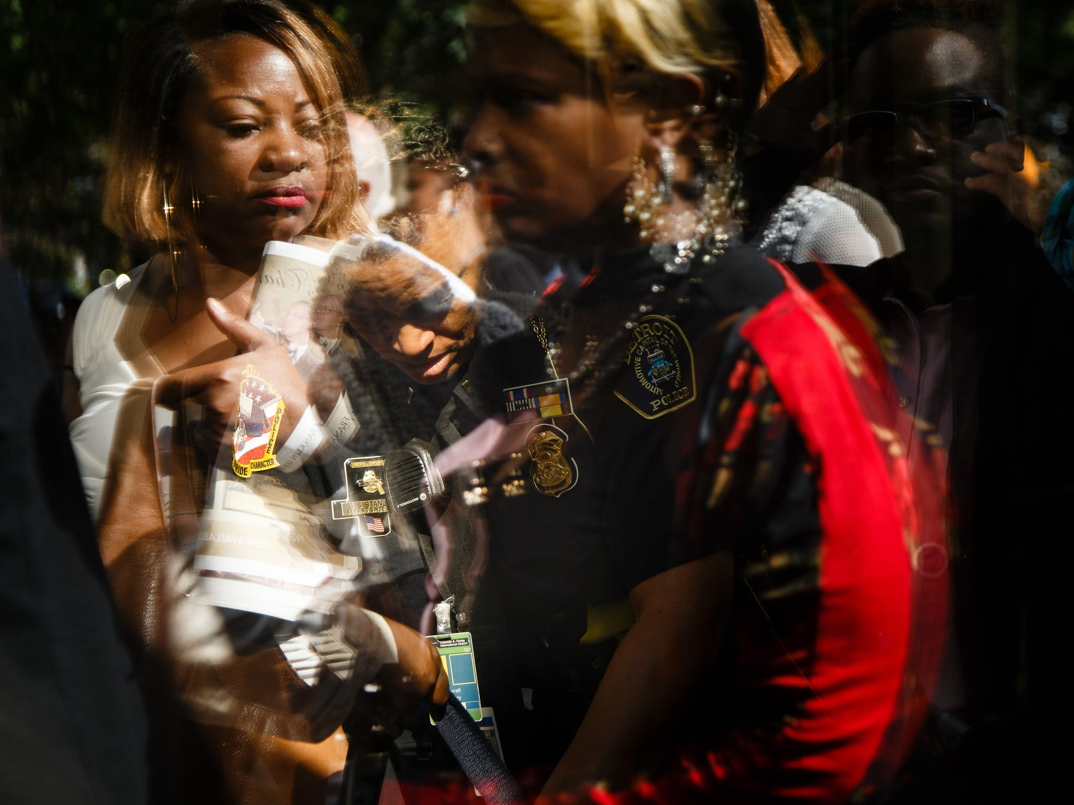People have their bags checked before entering Aretha Franklin's funeral at Greater Grace Temple on Friday, Aug. 31, 2018 in Detroit. Franklin died on August 16, 2018.