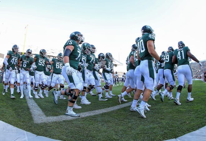 Michigan State Spartans take the field prior to the opener vs. the Utah State Aggies at Spartan Stadium on Aug. 31, 2018, in East Lansing.