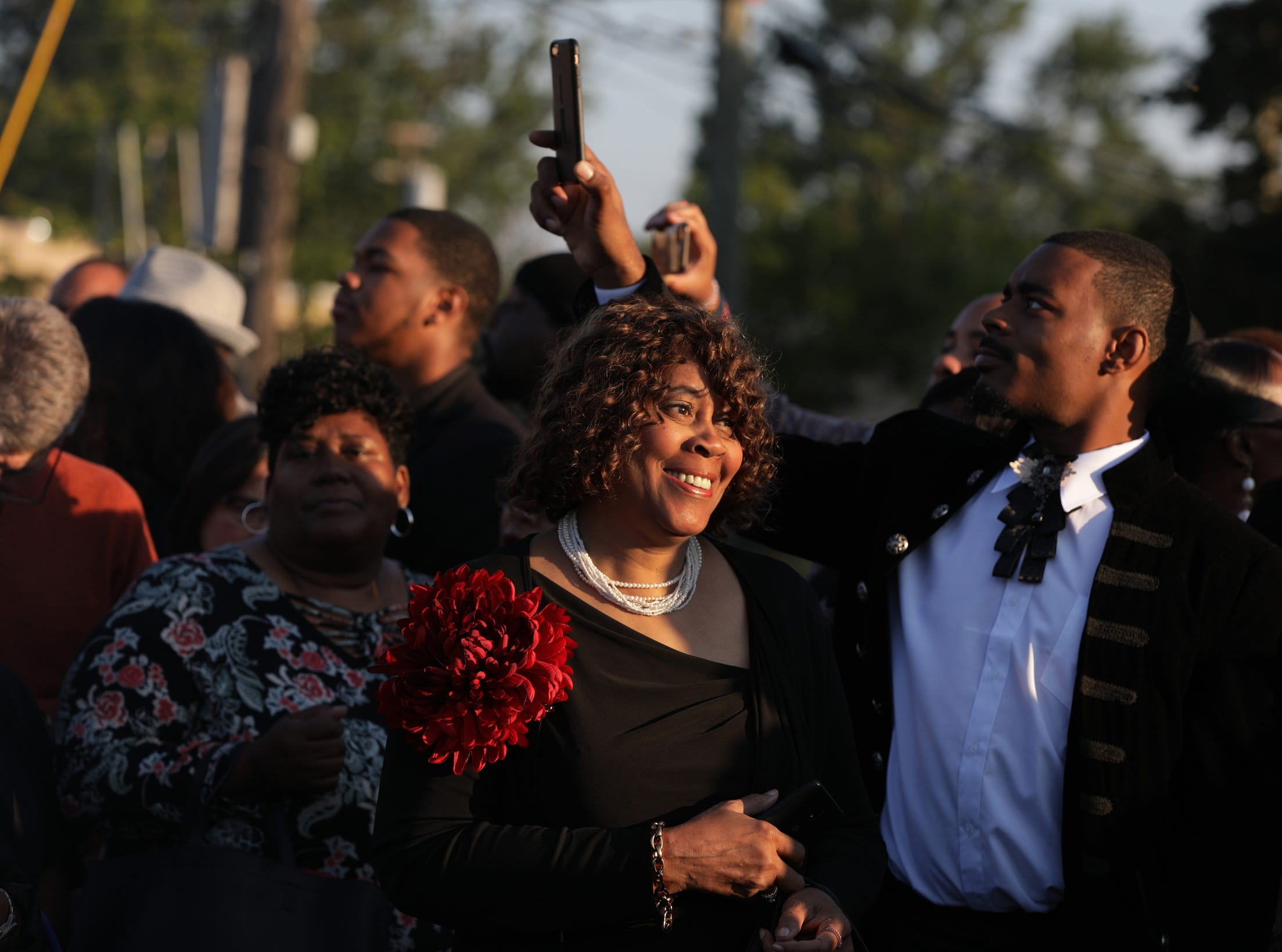 People break into a song as they wait in line for a chance to attend the funeral of Aretha Franklin at Greater Grace Temple on Friday, August 31, 2018.
