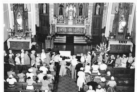 The funeral of Father Solanus Casey is held in Detroit in 1957.