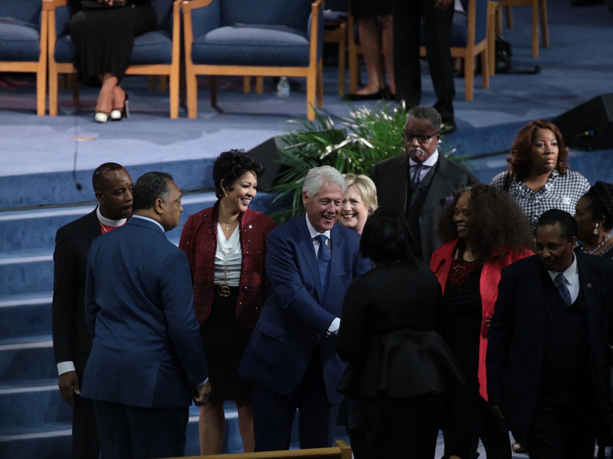 Former president Bill Clinton and Hillary Clinton greet people during the funeral for the late Aretha Franklin at Greater Grace Temple in Detroit on Friday, August 31, 2018.