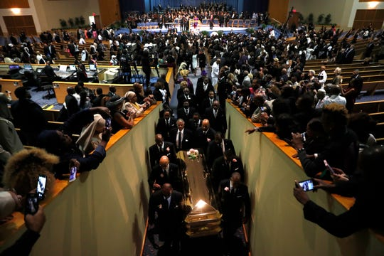Pallbearers carry the casket out of Greater Grace Temple at the end of the funeral for Aretha Franklin, Friday, Aug. 31, 2018, in Detroit. Franklin died Aug. 16, 2018 of pancreatic cancer at the age of 76.