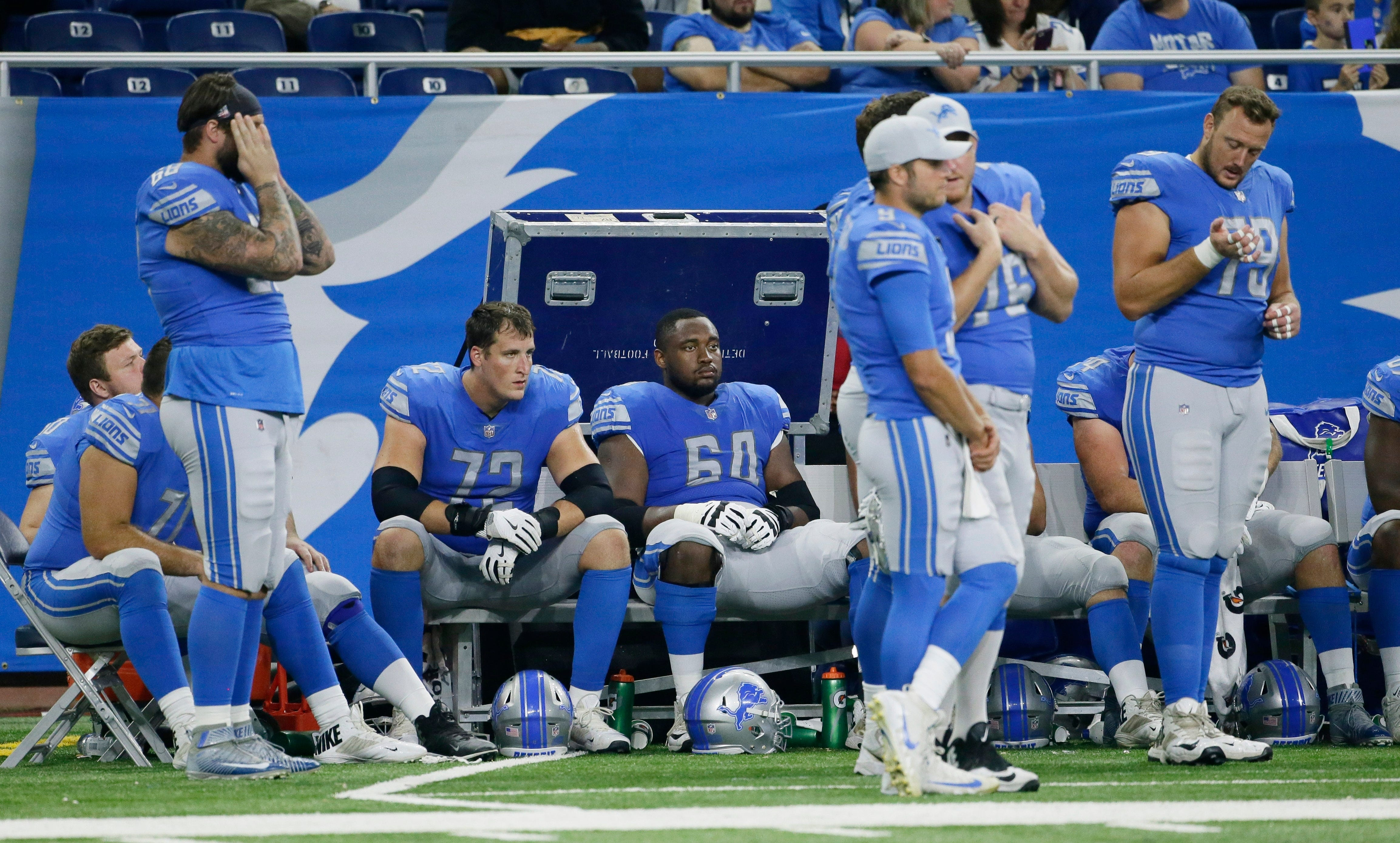 Lions players sit on the bench during the closing minute of the Lions' 35-17 preseason loss Thursday at Ford Field.