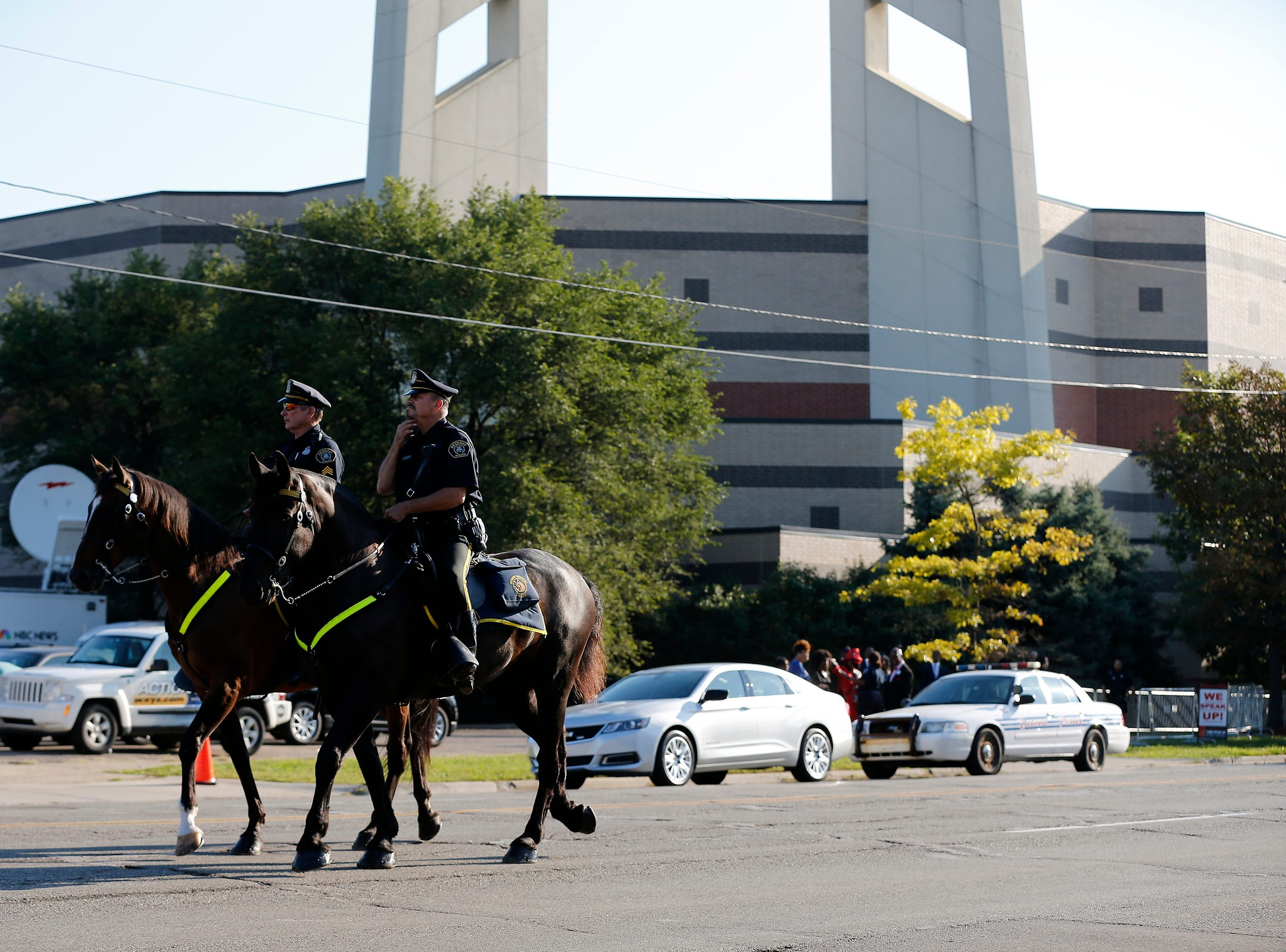 Mounted police arrive on 7 Mile Road during the funeral of Aretha Franklin outside the Greater Grace Temple in Detroit on Friday, Aug. 31, 2018.