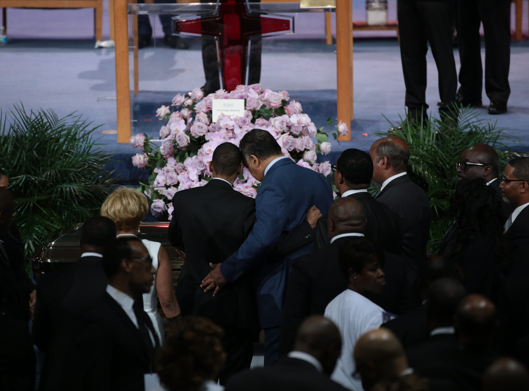 Rev. Jessie Jackson hugs a family member after the casket for the late Aretha Franklin was closed during the funeral for the late Aretha Franklin at Greater Grace Temple in Detroit on Friday, August 31, 2018.