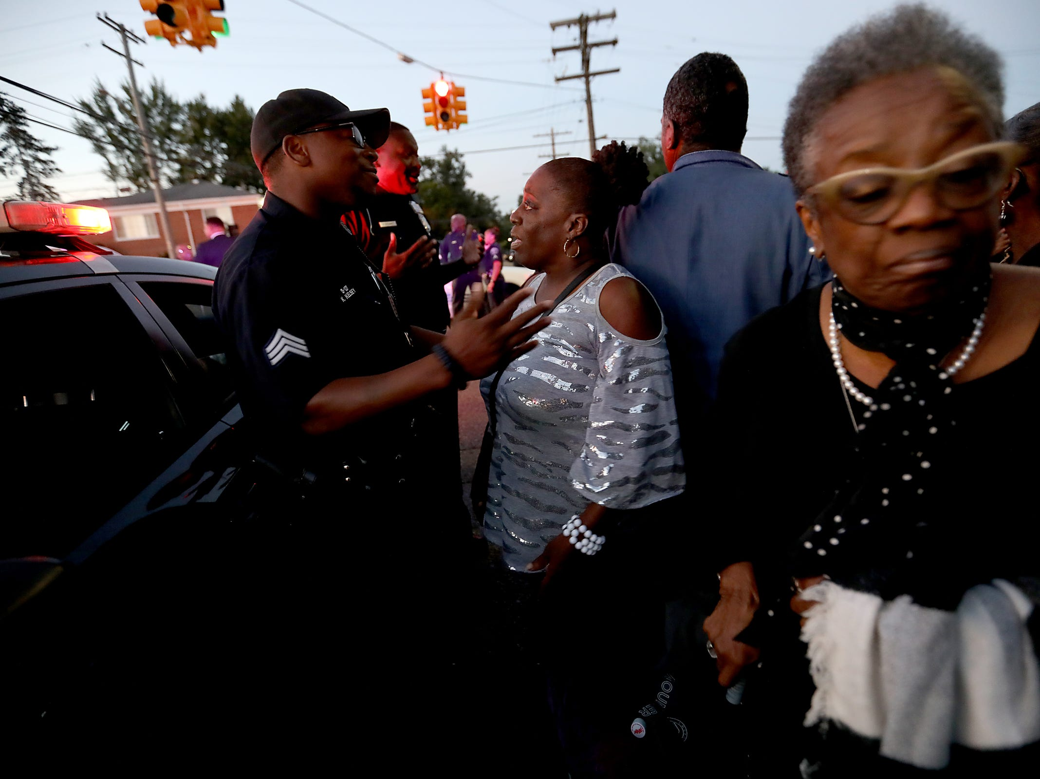 People who arrived the day before are pushed back by Detroit police near Greater Grace Temple as they wait in line to pay their final respects to Aretha Franklin in Detroit, on Friday, Aug. 31, 2018.