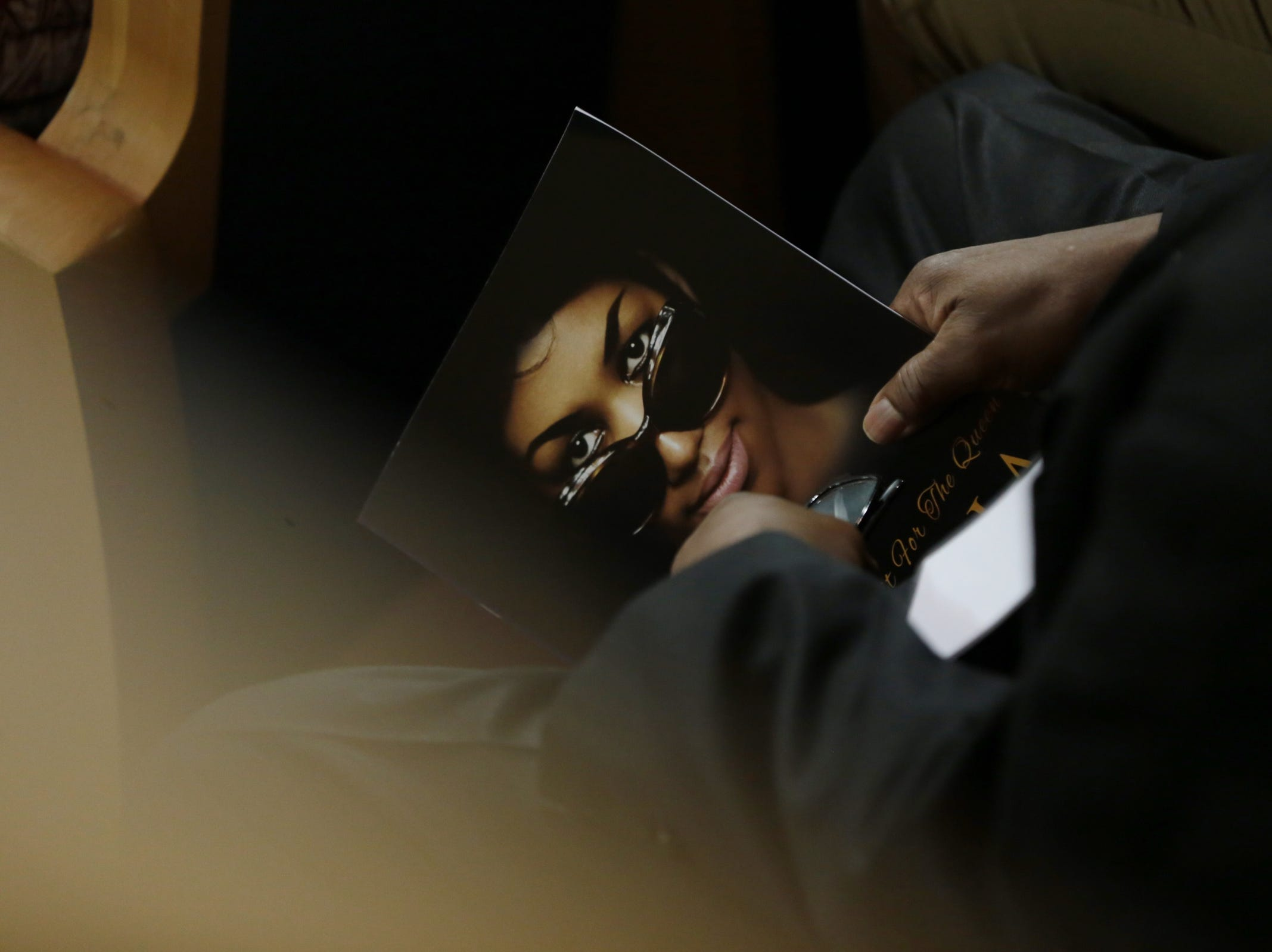 Attendees hold programs during the funeral for the late Aretha Franklin at Greater Grace Temple in Detroit on Friday, August 31, 2018.