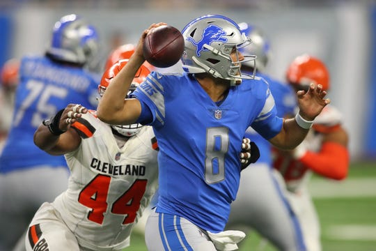 Detroit Lions QB Matt Cassel throws a pass while being pressured by Nate Orchard of the Cleveland Browns during a preseason game at Ford Field on August 30, 2018 in Detroit.