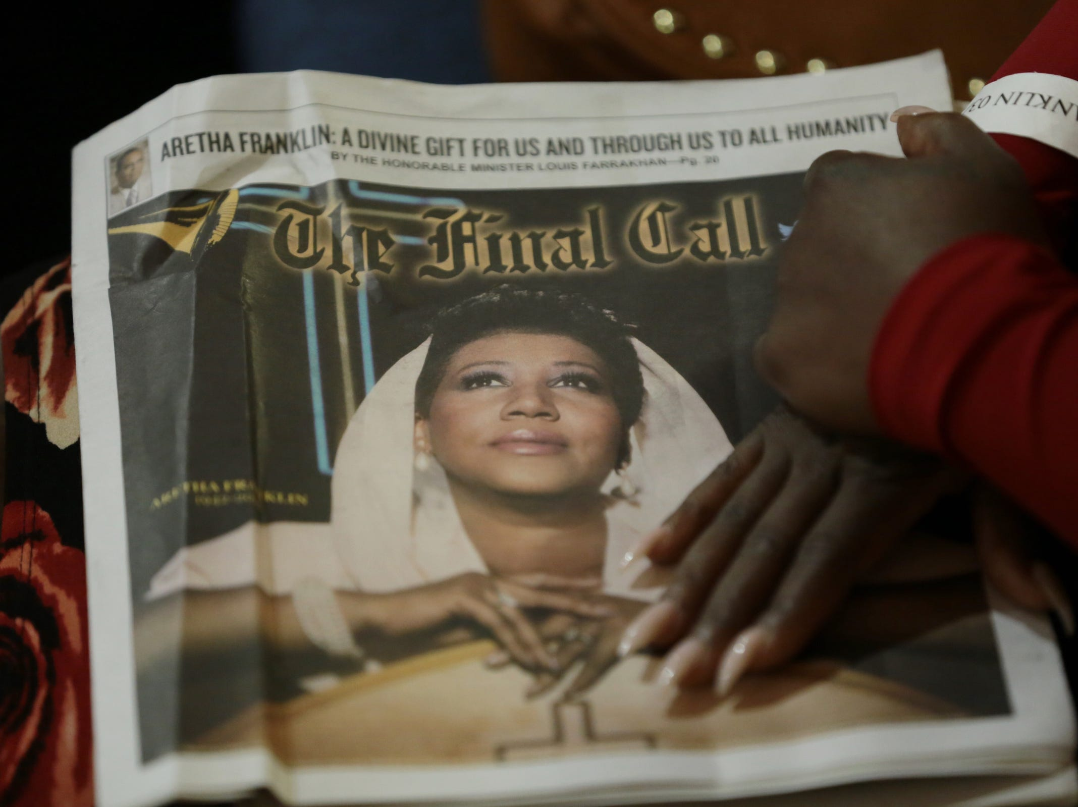 Attendees hold memorabilia during the funeral for the late Aretha Franklin at Greater Grace Temple in Detroit on Friday, August 31, 2018.